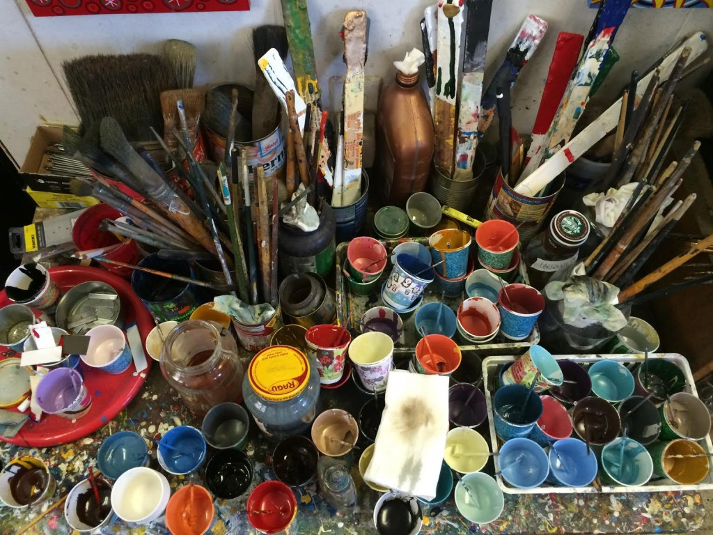 Color selection at Mystic Signs is an actual palette and jars of paint.